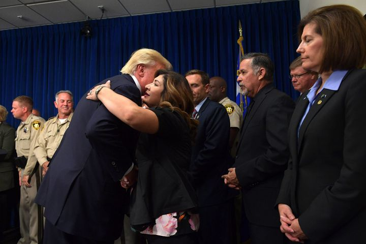 President Donald Trump salutes first responders as he visits the Metropolitan Police Department command center in Las Vegas o