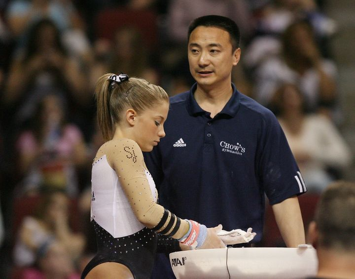 Liang Chow talks with Shawn Johnson during day 3 of the Visa Championships at Agganis Arena June 7, 2008 in Boston, Massachus