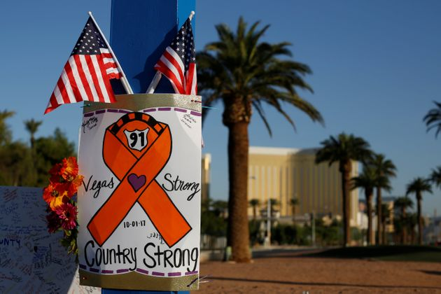 A makeshift memorial sits in the middle of Las Vegas Boulevard after the mass shooting in that