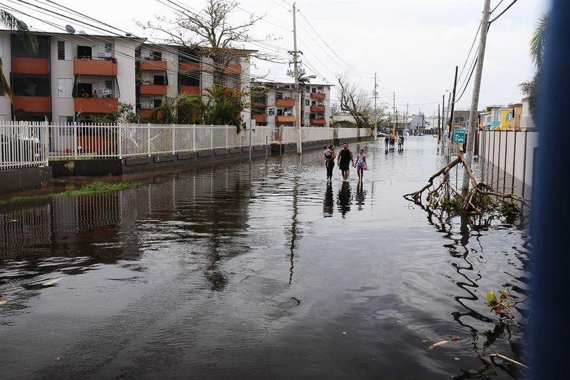 Puerto Rican residents walk in flooded streets in Condado, San Juan, Puerto Rico, Sept. 22, 2017, following Hurricane Maria.