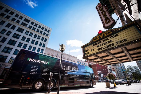 "The HuffPost bus parks in front of the Akron Civic Theater in Ohio during ""Listen To America: A HuffPost Road Trip."" The"