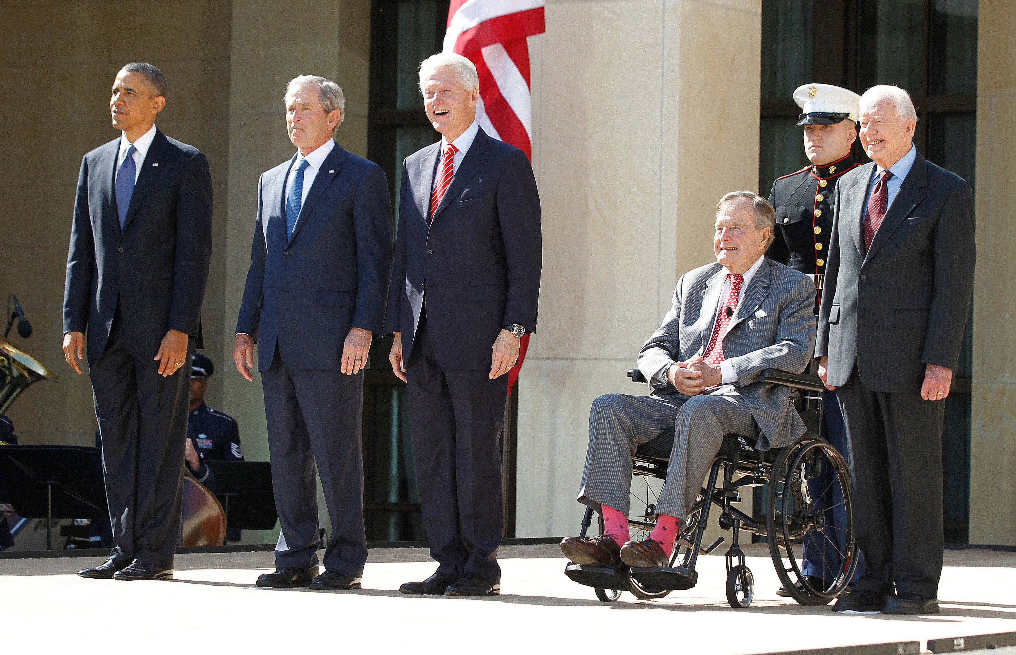 (From L - R) U.S. President Barack Obama stands alongside former presidents George W. Bush, Bill Clinton, George H.W. Bush and Jimmy Carter as they attend the dedication ceremony for the George W. Bush Presidential Center in Dallas, April 25, 2013. Obama is in Texas to stand shoulder-to-shoulder with former President George W. Bush in what could serve as a powerful reminder of the ongoing struggle against terrorism, from the Sept. 11 attacks to the Boston Marathon bombings. REUTERS/Jason Reed (UNITED STATES - Tags: POLITICS)