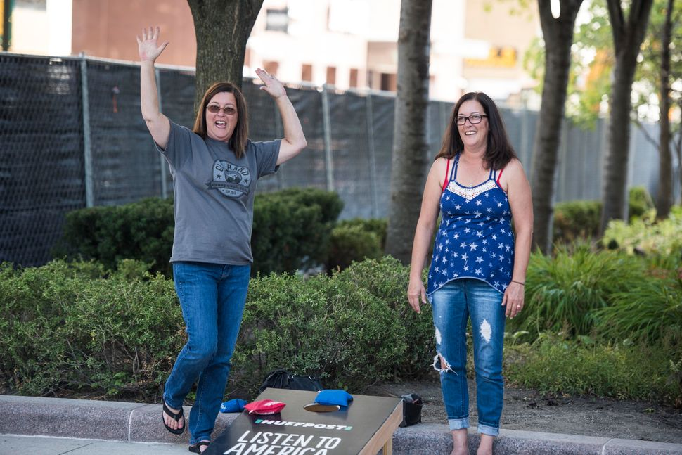 Wendy Agbay and Christy Barford play a game of cornhole.