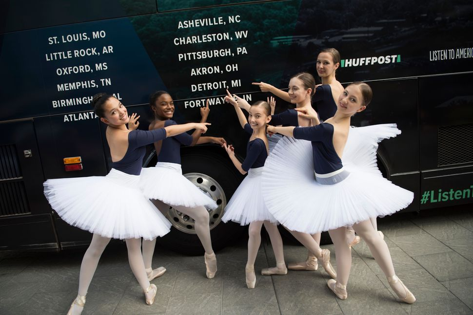 Dancers from Ballet Detroit pose for a photo in front of the bus.