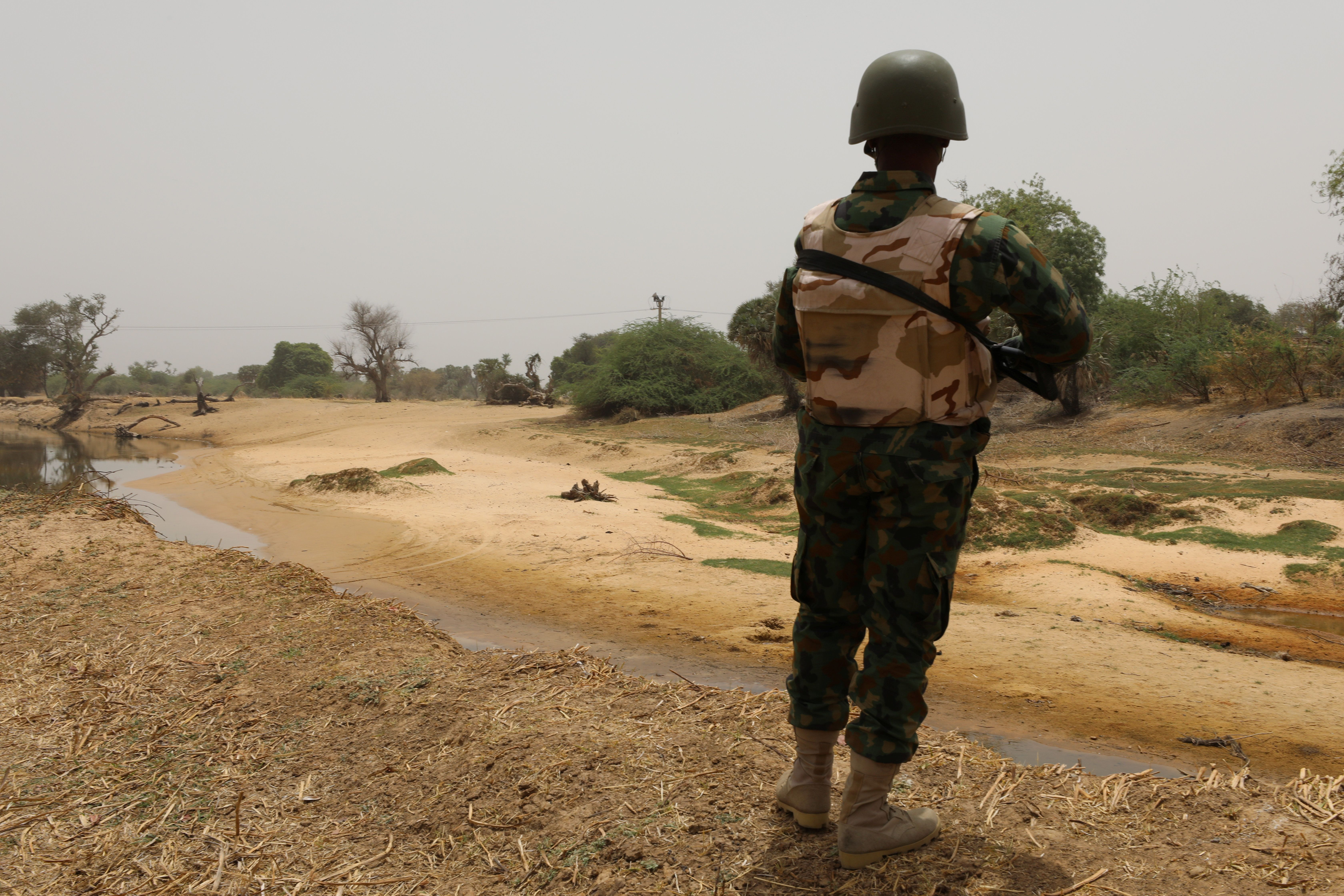 A Nigerian soldier stands watching the boarder with Niger at Damasak, Borno, Nigeria April 25, 2017. REUTERS/Afolabi Sotunde
