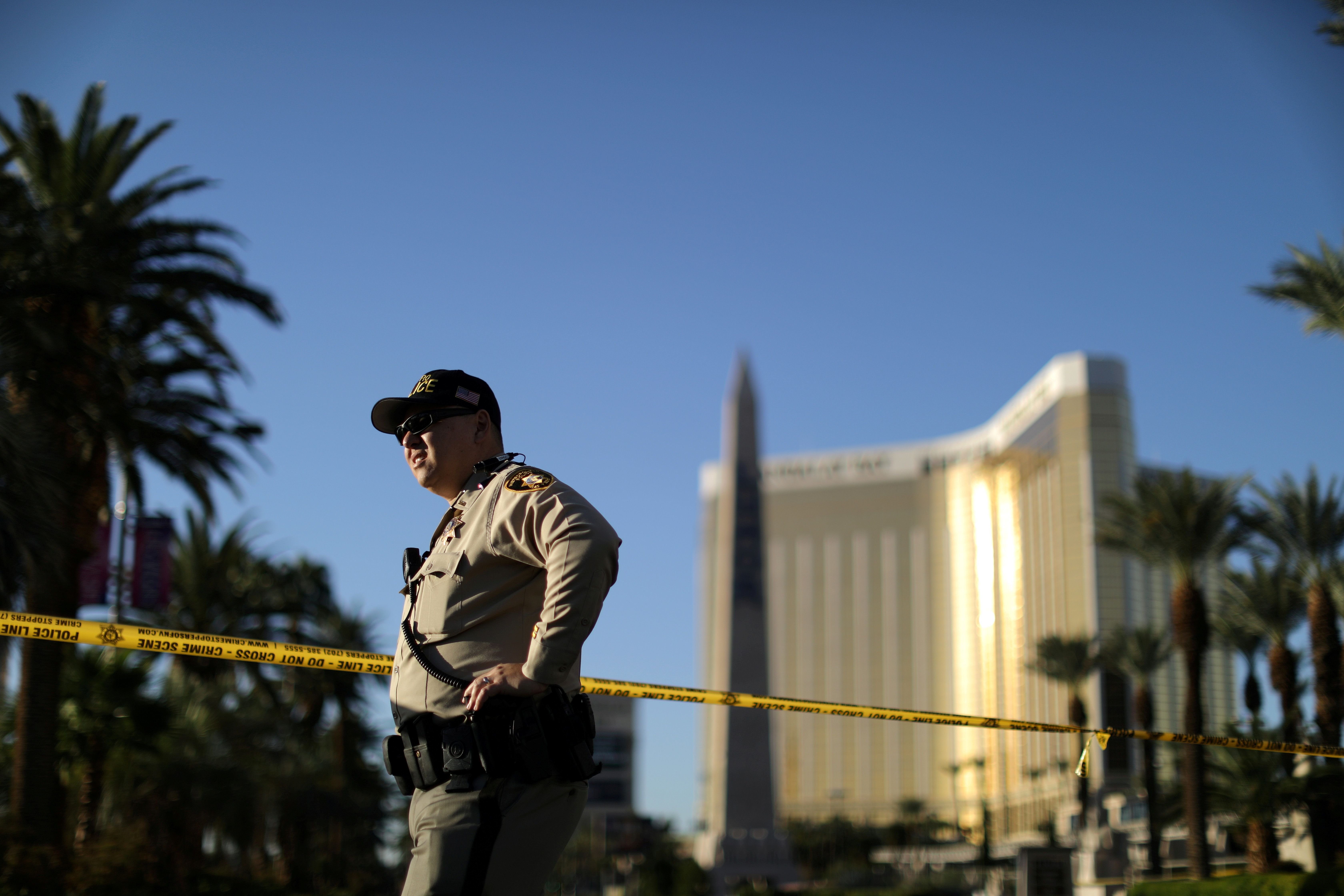 A police officer stands in front of the closed Las Vegas Strip next to the site of the Route 91 music festival mass shooting outside the Mandalay Bay Resort and Casino in Las Vegas, Nevada, U.S., October 3, 2017. REUTERS/Lucy Nicholson
