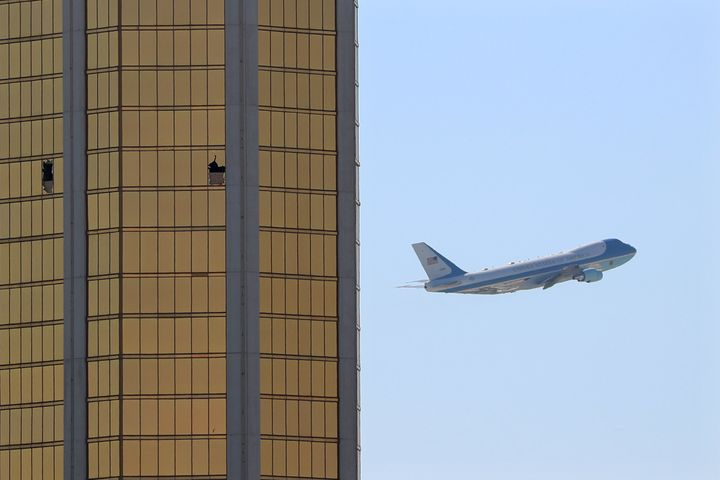Air Force One departs Las Vegas past the broken windows on the Mandalay Bay hotel, where shooter Stephen Paddock conducted hi
