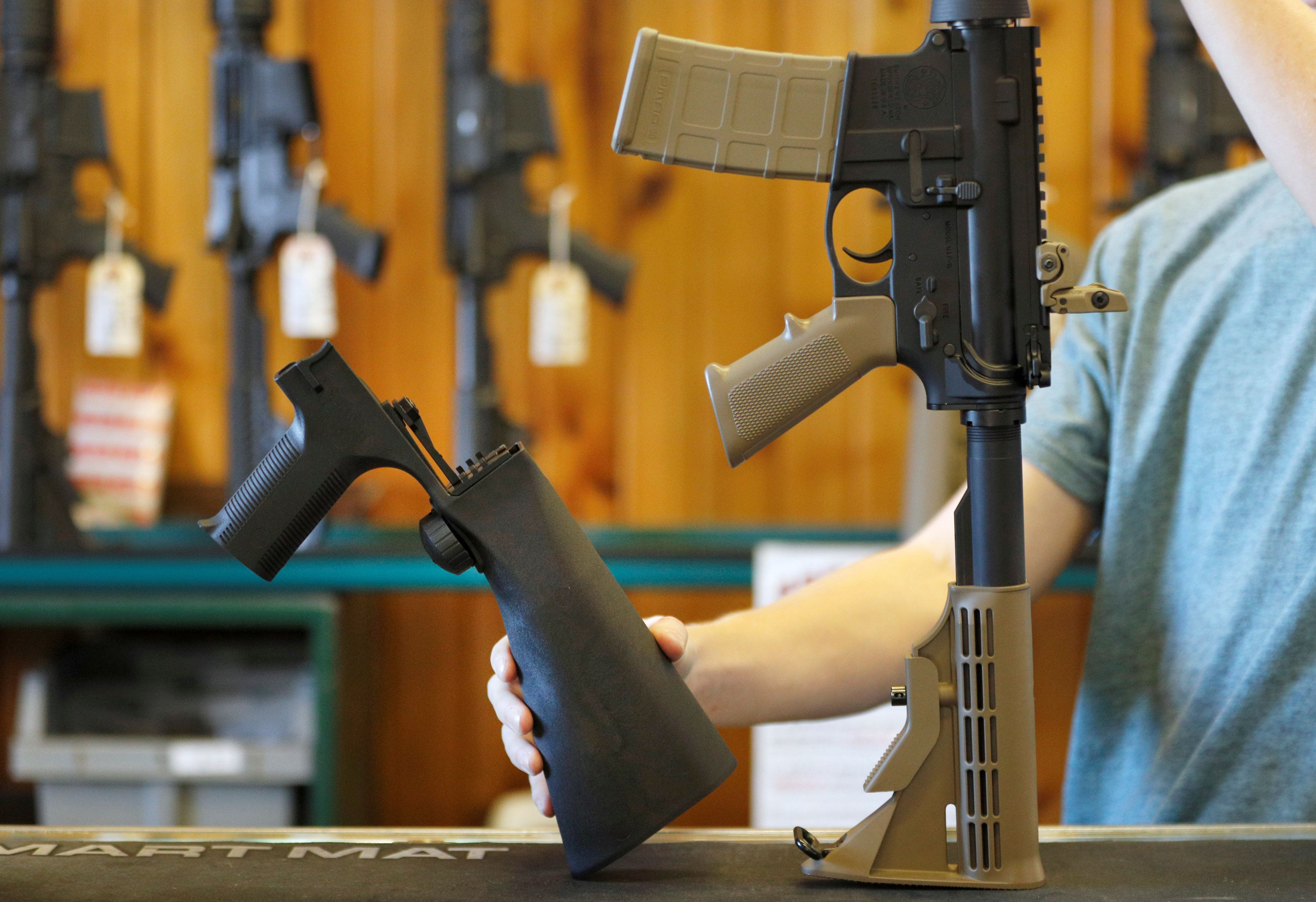 A bump fire stock, (L), that attaches to an semi-automatic assault rifle to increase the firing rate is seen at Good Guys Gun Shop in Orem, Utah, U.S., October 4, 2017. REUTERS/George Frey