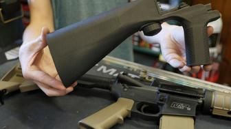 A bump fire stock that attaches to an semi-automatic assault rifle to increase the firing rate is seen at Good Guys Gun Shop in Orem, Utah, U.S., October 4, 2017. REUTERS/George Frey
