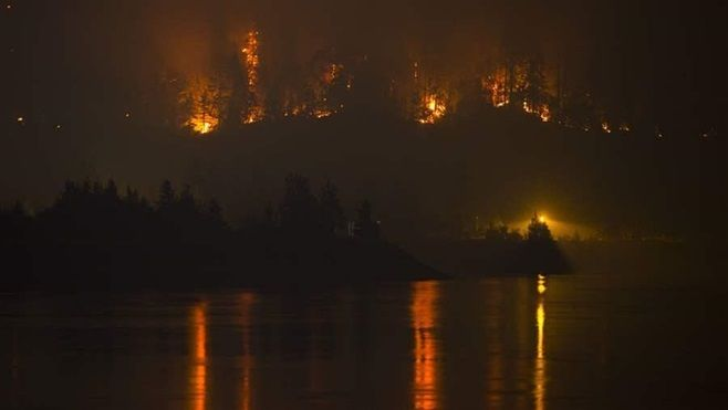 A September wildfire burns in Washington state. In nearby Montana, the state's worst fire season in years continued to scorch