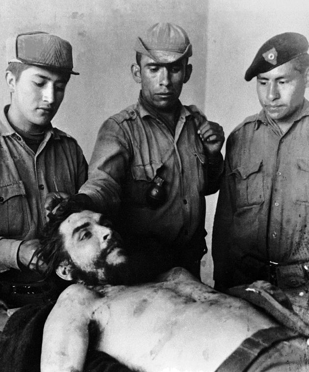 Bolivian soldiers with the body of Guevara, as he lay dead on the laundry room sink of Vallegrande hospital,...