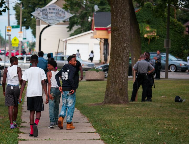 MILWAUKEE, WI - AUGUST 15: Members of the Milwaukee County Sheriff Dept. secure Sherman Park after a 6pm curfew was enacted a