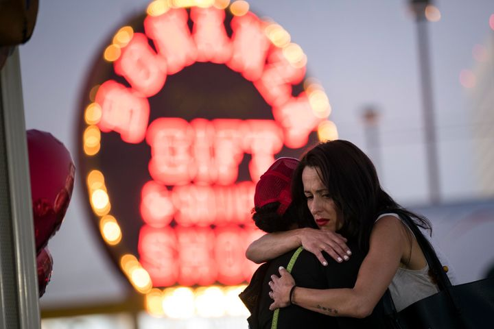 Two women hug at a makeshift memorial at the northern end of the Last Vegas Strip on Wednesday.