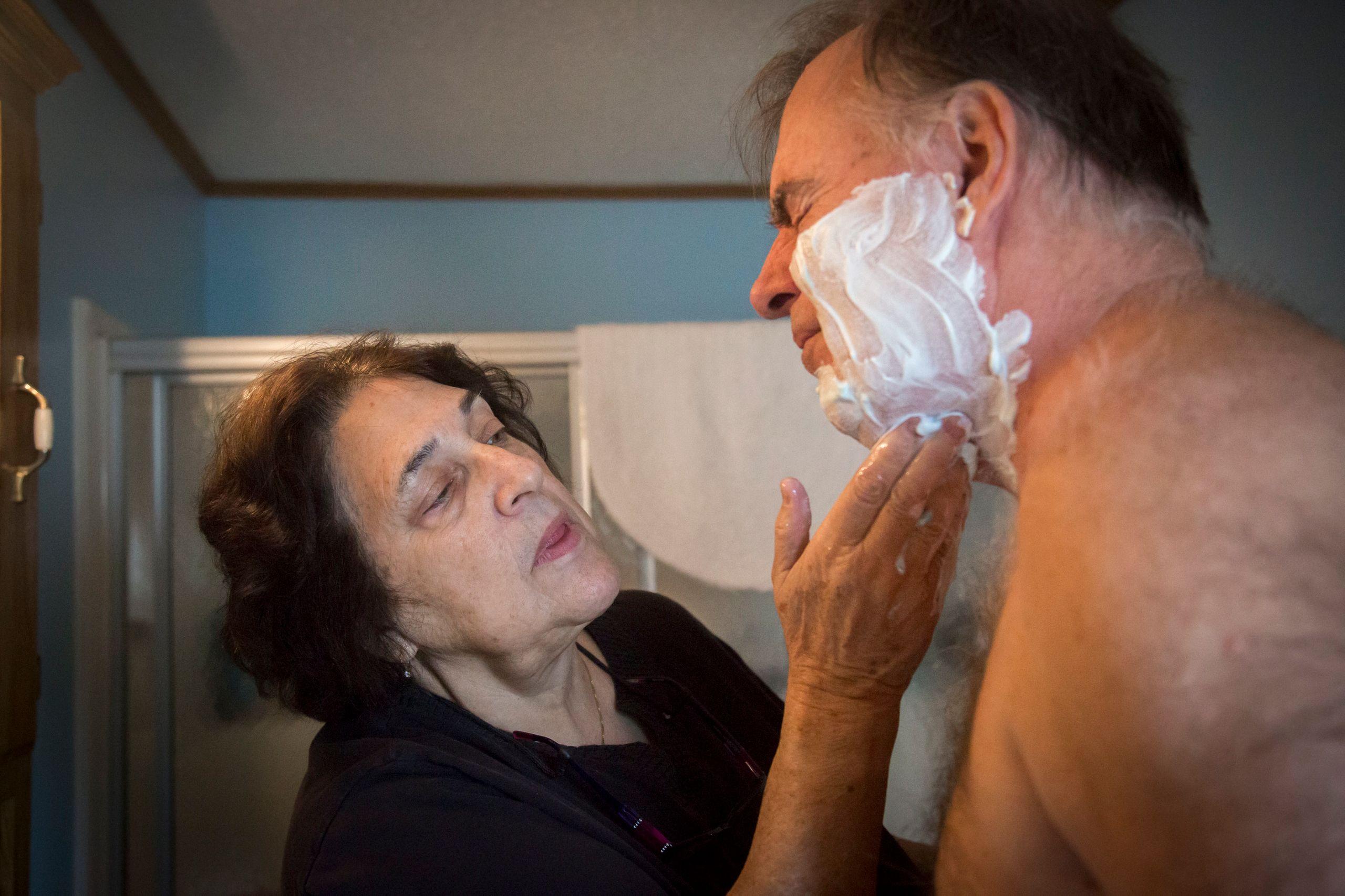 Anne Scherer helps Alan with everyday tasks.