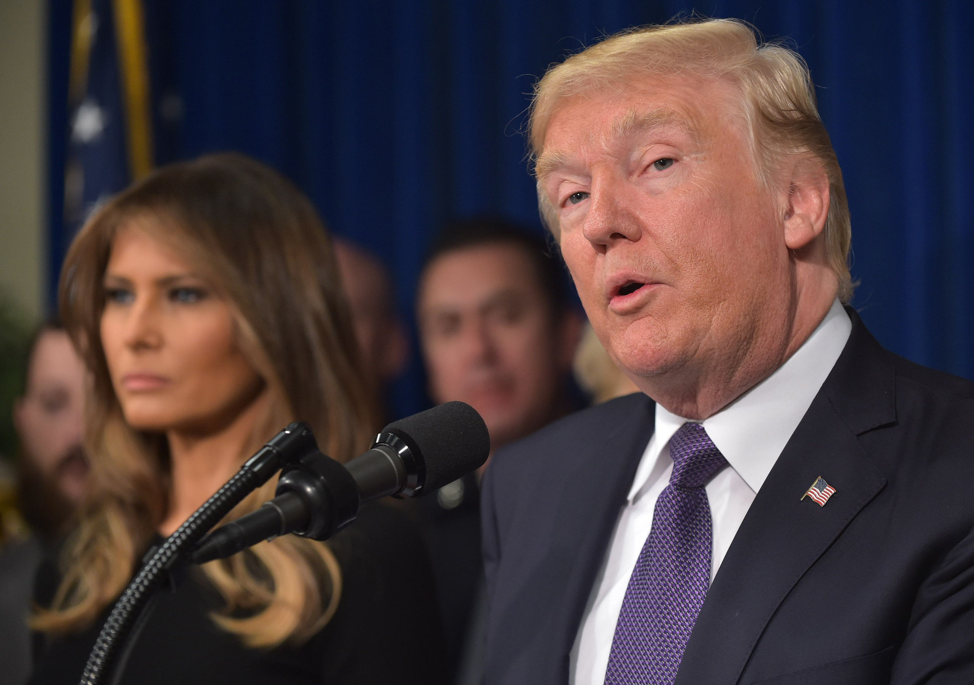 US President Donald Trump speaks as First Lady Melania Trump (L) looks on as he visits the Metropolitan Police Department command centre in Las Vegas, Nevada on October 4, 2017.   / AFP PHOTO / MANDEL NGAN        (Photo credit should read MANDEL NGAN/AFP/Getty Images)