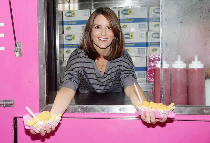"Tina Fey hands out cheese fries at the launch event for the Broadway musical production of her film ""Mean Girls."""