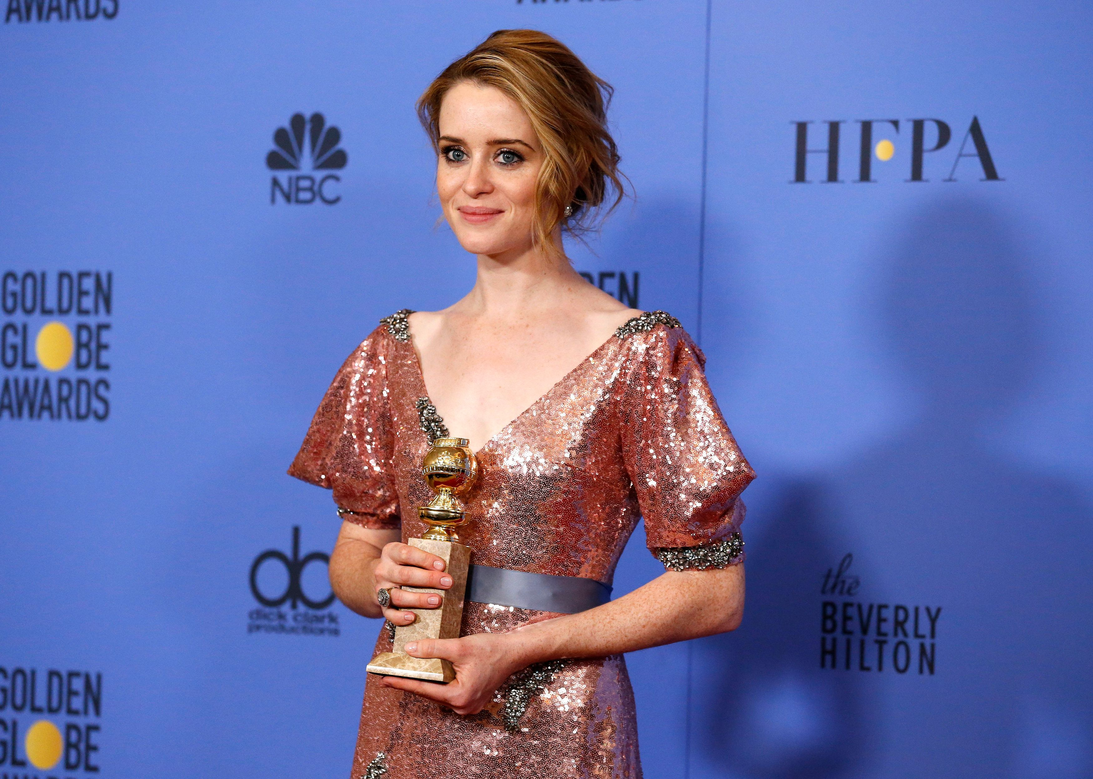 "Actress Claire Foy holds the award for Best Performance by an Actress In A Television Series - Drama for her role in ""The Crown"" during the 74th Annual Golden Globe Awards in Beverly Hills, California, U.S., January 8, 2017.   REUTERS/Mario Anzuoni"