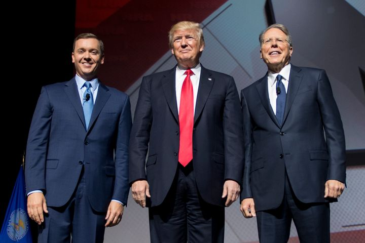 President Donald Trump (center) stands beside NRA CEO and executive vice president Wayne LaPierre (right) and NRA-I