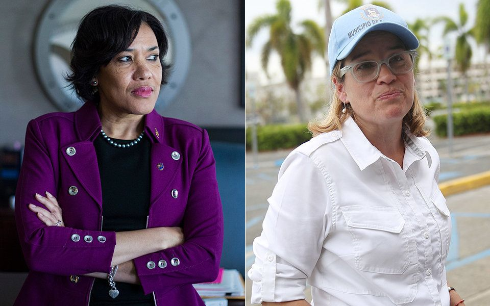 Karen Weaver (left), the mayor of Flint, Michigan, and Carmen Yulín Cruz, the mayor of San Juan, Puerto Rico.