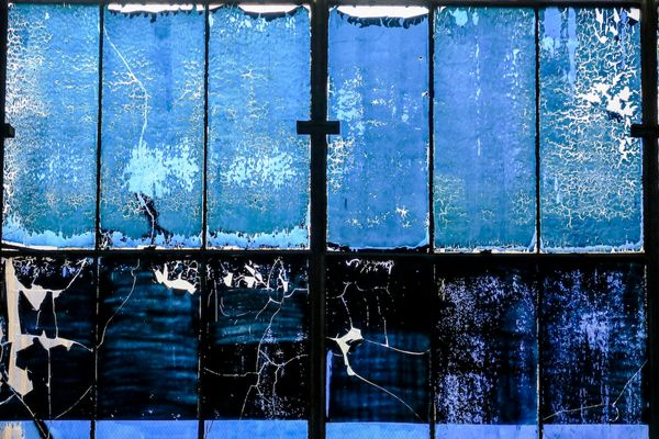 Blue film covering the windows at General Electric's abandoned manufacturing plant