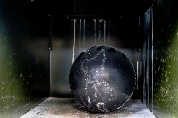 An abandoned bowling ball at the General Electric employee clubhouse.