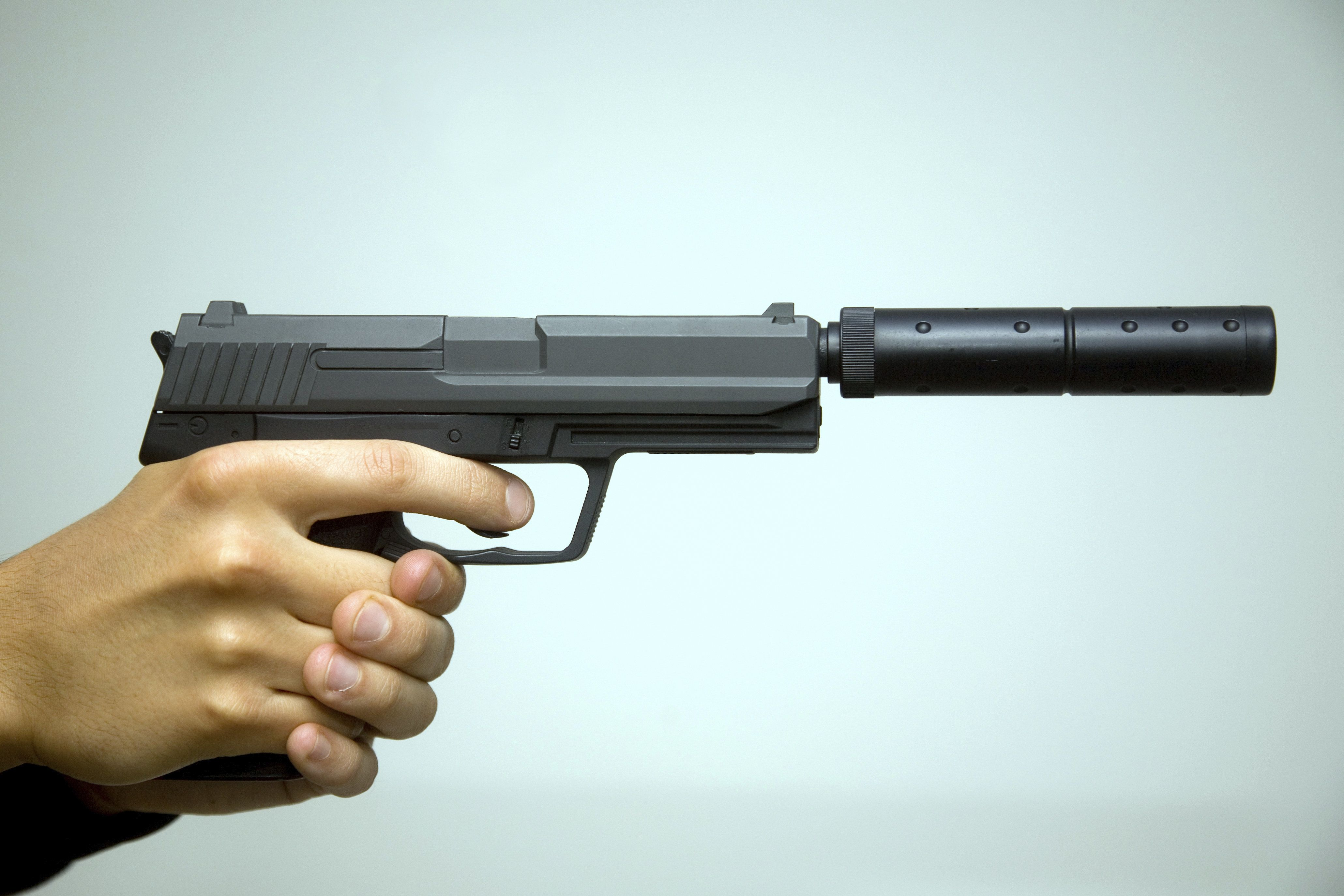A semi automatic handgun with silencer.
