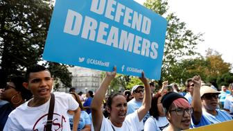 A woman holds a sign during a rally calling for the passage of a clean Dream Act outside the U.S. Capitol in Washington, U.S., September 26, 2017. REUTERS/Kevin Lamarque