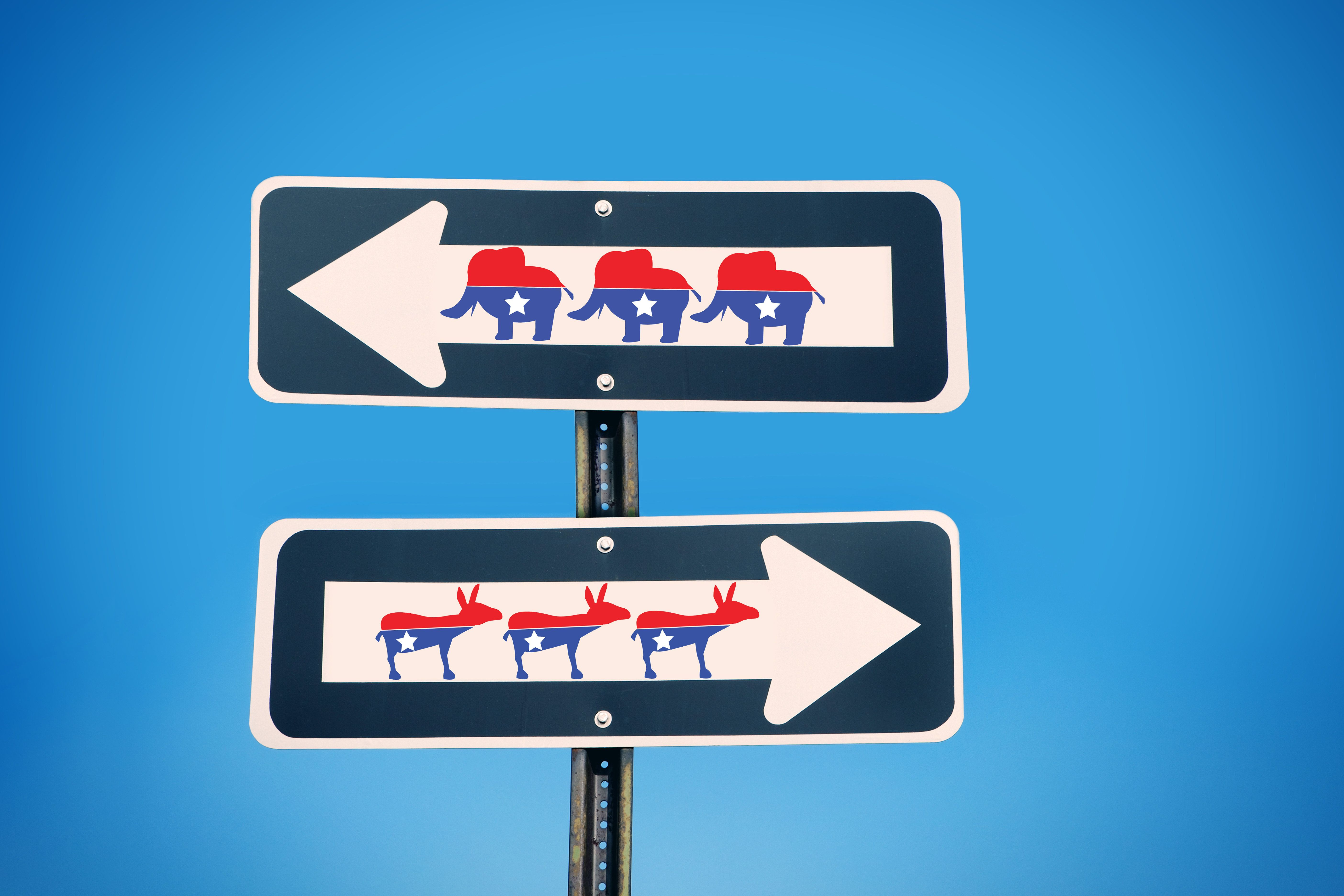 Two one way signs pointing in opposite directions with the democratic donkey and republican elephant on them.