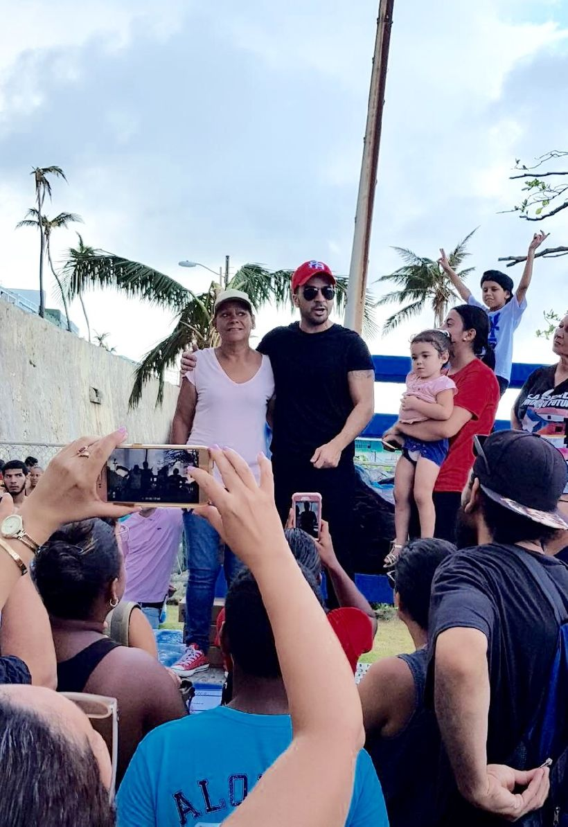 Famed <em>Despacito</em> singer Luis Fonsi made an impromptu visit to the barrio La Perla  Monday, promising to lend a hand i