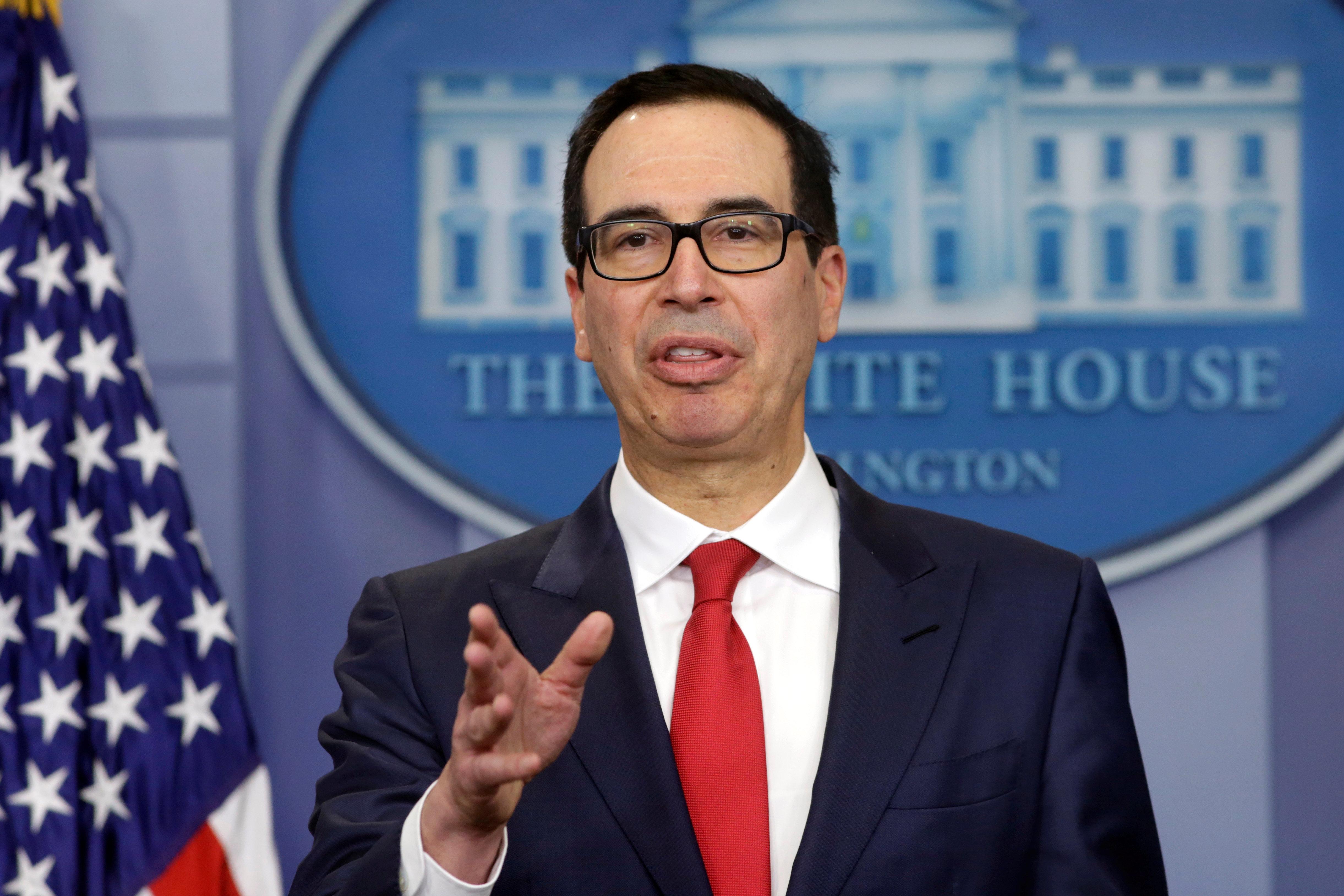 U.S. Treasury Secretary Steve Mnuchin speaks during a news briefing at the White House in Washington, U.S., to announce sanctions against Venezuela, August 25, 2017. REUTERS/Yuri Gripas