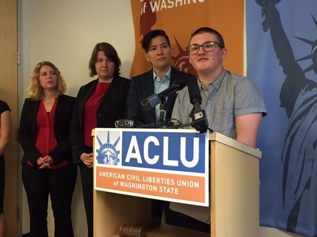 Pax Enstad discusses his lawsuit with reporters at ACLU Washington Thursday.