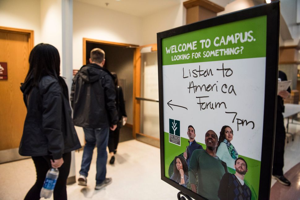 """A sign directs guests to the """"Vouchers: The Economics and Academics of Choice"""" event at Ivy Tech Community College in Fort Wa"""