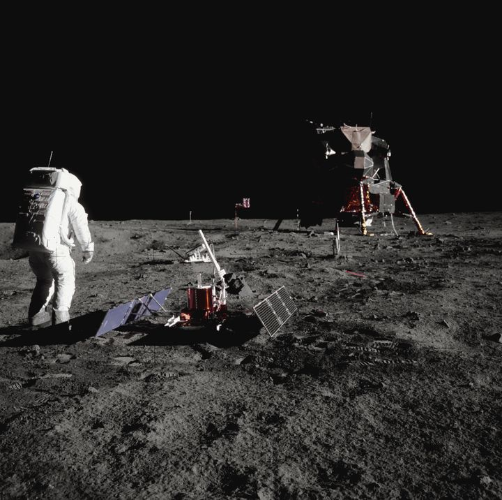 Buzz Aldrin walks by some scientific equipment on the surface of the Moon during the Apollo 11 mission.
