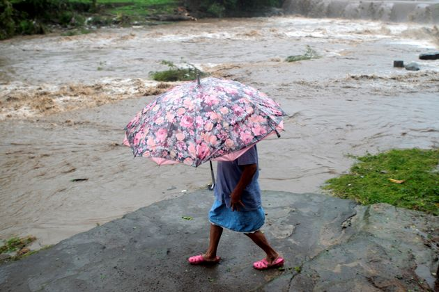 A woman walks on the shore of the Masachapa River on the outskirts of