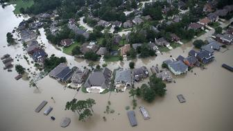 HOUSTON, TX - AUGUST 30:  Flooded homes are shown near Lake Houston following Hurricane Harvey August 30, 2017 in Houston, Texas. The city of Houston is still experiencing severe flooding in some areas due to the accumulation of historic levels of rainfall, though the storm has moved to the north and east.  (Photo by Win McNamee/Getty Images)