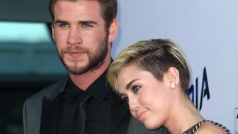 LOS ANGELES, CA - AUGUST 08:  Actors Liam Hemsworth (L) and Miley Cyrus attend the premiere of Relativity Media's 'Paranoia' at the DGA Theater on August 8, 2013 in Los Angeles, California.  (Photo by David Livingston/Getty Images)