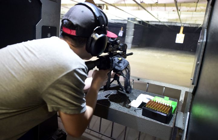 A gun enthusiast fires his AR-15 rifle toward a target at the LAX Firing Range in Inglewood, California, on Sept. 7, 2016.
