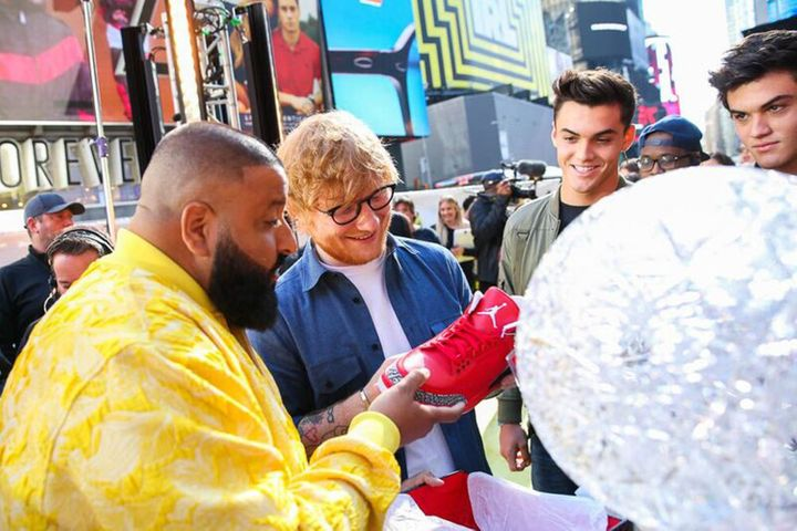 DJ Khaled, Ed Sheeran, Ethan Dalton and Grayson Dalton view Nike Air Jordan sneakers during the MTV TRL Kick-Off at Times Squ