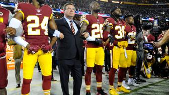 Sep 24, 2017; Landover, MD, USA; Washington Redskins owner Daniel Snyder stands with cornerback Josh Norman (24) and cornerback Bashaud Breeland (26) and safety D.J. Swearinger (36) during the playing of the national anthem before the game between the Washington Redskins and the Oakland Raiders at FedEx Field. Mandatory Credit: Brad Mills-USA TODAY Sports