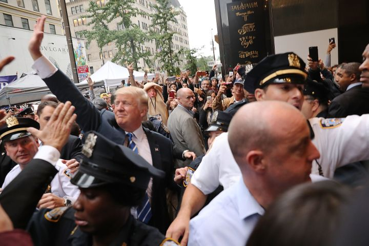 Donald Trump greets supporters outside Trump Tower on Oct. 8, 2016.