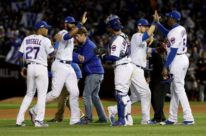 The Chicago Cubs celebrate after beating the San Francisco Giants at Wrigley Field on Oct. 8, 2016.