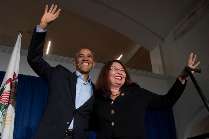 President Barack Obama waves to the crowd with Rep. Tammy Duckworth, D-Ill., during an event in Chicago on Oct. 9, 2016.