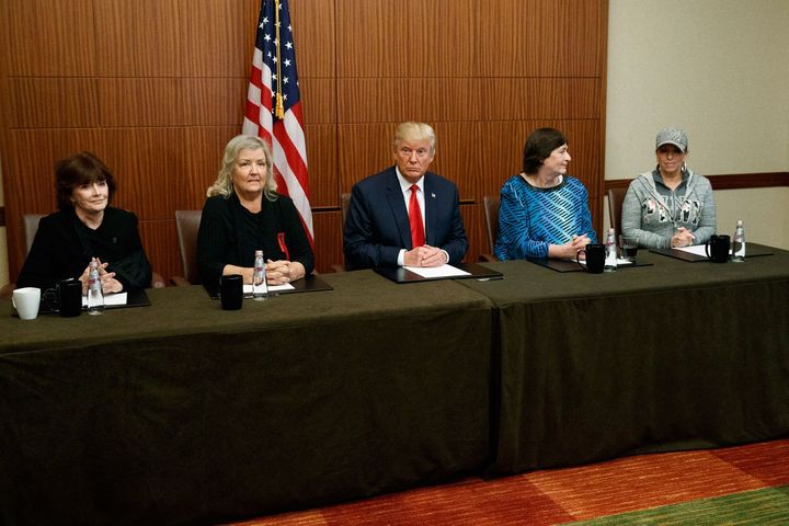 Trump sits with, from left, Kathleen Willey, Juanita Broaddrick, Kathy Shelton and Paula Jones on Oct. 9, 2016, before the se