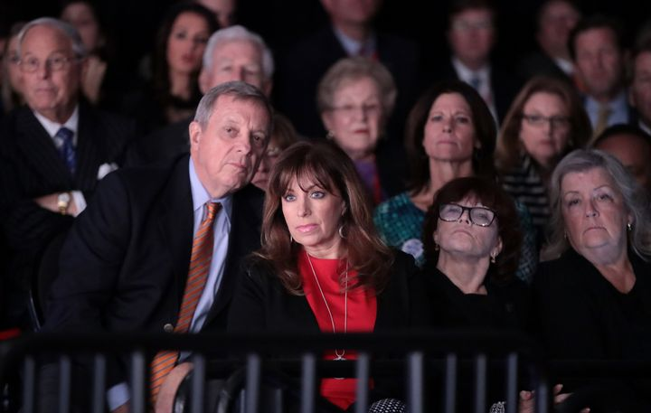 Dick Durbin (left) sits behind (left to right) Paula Jones, Kathleen Willey and Juanita Broaddrick at the presidential debate