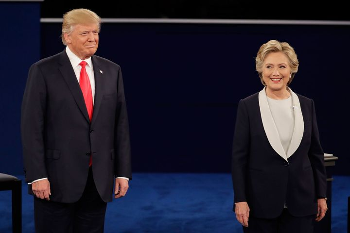 Trump stands next to Clinton during the second presidential debate, Oct. 9, 2016.