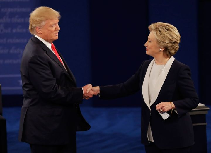 Trump shakes hands with Clinton following the second presidential debate, Oct. 9, 2016.