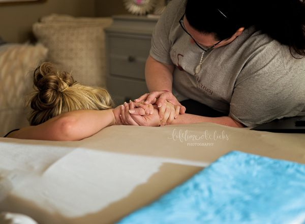 """""""This images is of one my favorite midwives. She is helping mom through one of the last transitions. As you can see, she is c"""
