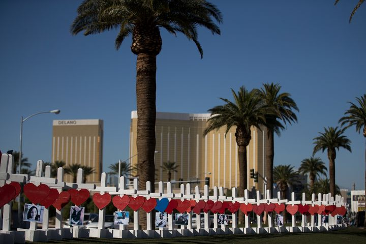 With the Mandalay Bay Resort and Casino in the background (at right), 58 white crosses for the victims of Sunday night's mass