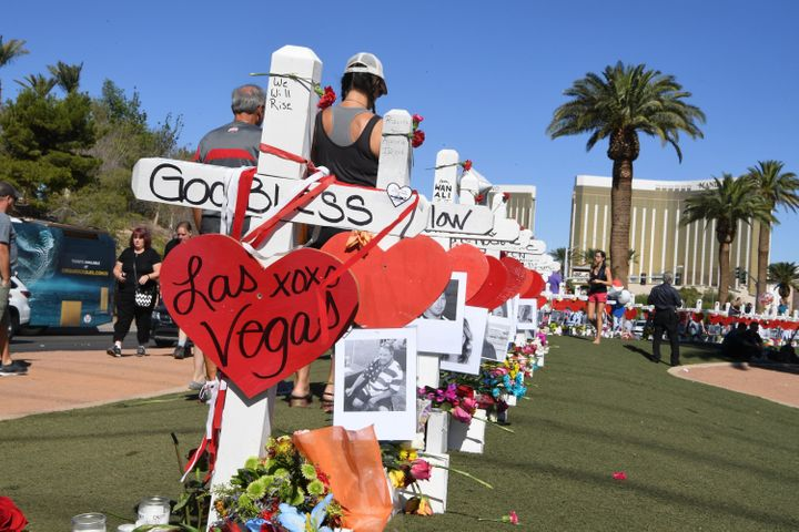 Mourners decorate the crosses.