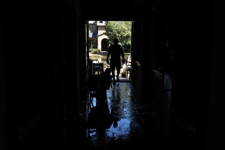 Homeowner Maurice Teixeira stands in the entrance way to his family home as he begins cleanup after floodwaters receded in th